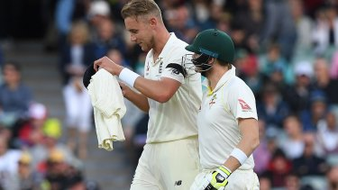 Steve Smith has words with Stuart Broad at the end of his over in Adelaide.
