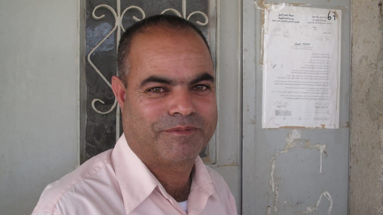 Khalil al-Amour with a notice of eviction pinned to the front door of his home in the Negev Desert village of al-Sira in 2011.