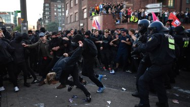 Police forces clash with protesters during a march on Friday in Hamburg.