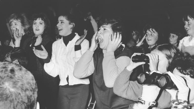 Teenage fans at the Beatles concert in 1964.