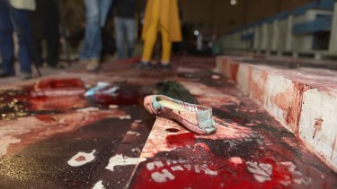 A girl's shoe lies on the floor in the bloodied ceremony hall where many students were executed.