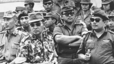 Indonesia's Major-General Suharto, in camouflage uniform, at the funeral for six generals killed by rebels in the abortive attempt to overthrow then president Sukarno in 1965. The coup attempt led to nationwide massacres.