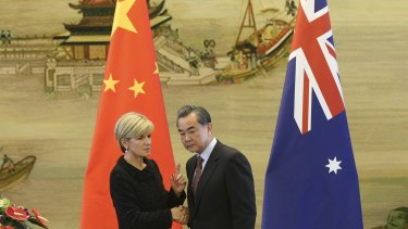 Australian Foreign Affairs Minister Julie Bishop shakes hands with Chinese Foreign Minister Wang Yi during their joint press conference at the Ministry of Foreign Affairs in Beijing.