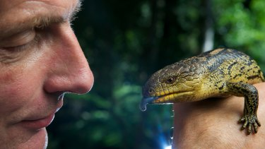 Mark Norman, head of sciences at Museum Victoria, with a blue tongue lizard.
