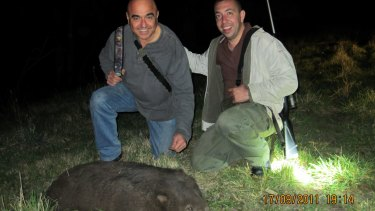 Tony Azzi,  left, and Nick Karagiannis with a dead wombat.