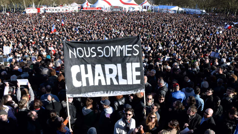 "People hold a banner reading in French ""We are Charlie"" during a march in Bordeaux."