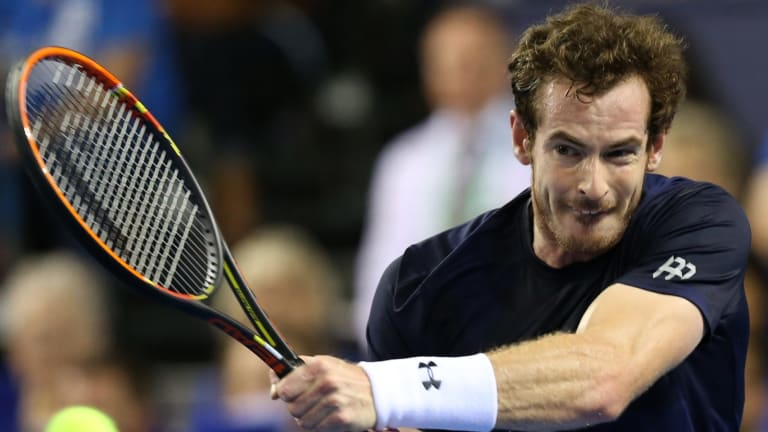 Forceful: Andy Murray during a 2015 Davis Cup singles match against Bernard Tomic.
