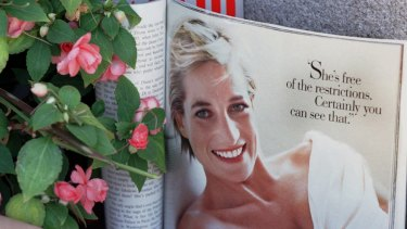 A past issue of <i>Vanity Fair</i> magazine lies open to a photograph of Princess Diana at a memorial in San Francisco following her death.