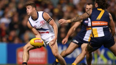 Riley Knight (left) made his debut for Adelaide amid the sadness of Phil Walsh's death.
