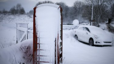 An abandoned car and telephone box near Ashbourne in the English Midlands.