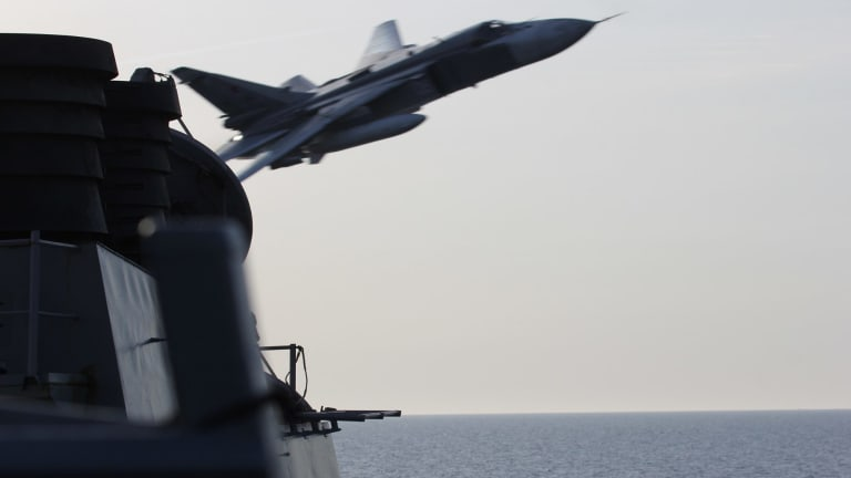 A Russian SU-24 jet makes a close-range and low altitude pass near the USS Donald Cook in 2016 in the Baltic Sea.