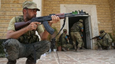 """Members of the Free Syrian Army carry out a house-to-house search of Jarablus after taking control of the town from Islamic State as part of """"Operation Euphrates Shield""""."""