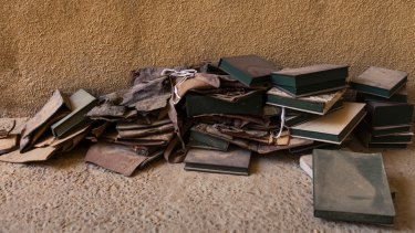 Empty boxes from manuscripts burned by Islamist rebels in Timbuktu. Abdel Kader Haidara organized the evacuation of about 300,000 manuscripts before the fighters invaded.