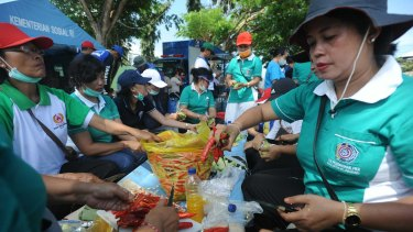 Food is prepared at an evacuee centre at Klungkung sport centre.