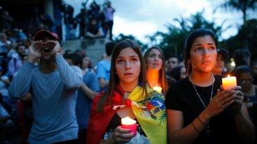 Anti-government demonstrators at a candlelight vigil last month in honour of those who have been killed during clashes between security forces and demonstrators in Venezuela's capital, Caracas. At least 125 people have died in street protests in the past four months.