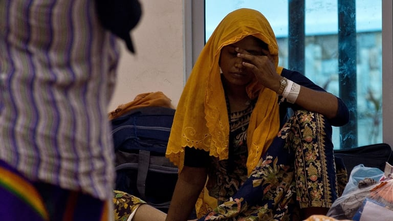 Rohingya migrants wait at a temporary detention centre in Langkawi, Malaysia on Tuesday.