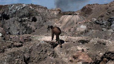 """A """"creuseur,"""" or digger, climbs through a cobalt and copper mine in Kawama, in the Democratic Republic of the Congo. Sixty per cent of the world's cobalt comes from the Congo."""
