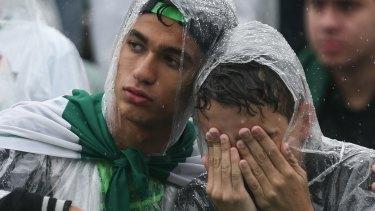 Grief-stricken: Fans at a Chapecoense memorial service.
