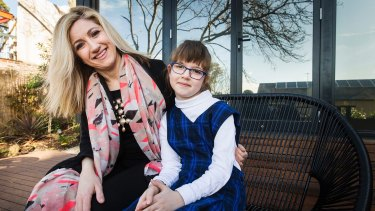Michelle Cooper relies on before-school care for her daughter Macy.