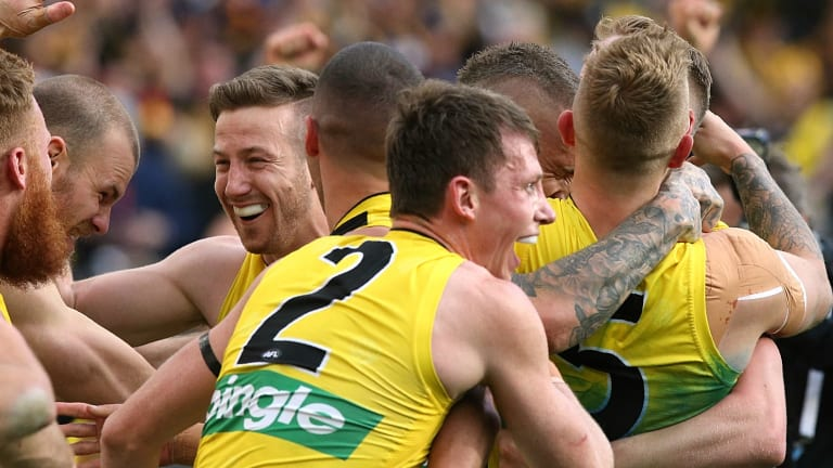 Dylan Grimes (No.2) embraces his teammates after the siren in the 2017 AFL grand final.