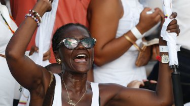 A woman shouts slogans in support of the peace agreement in Cartagena, Colombia, on Monday.