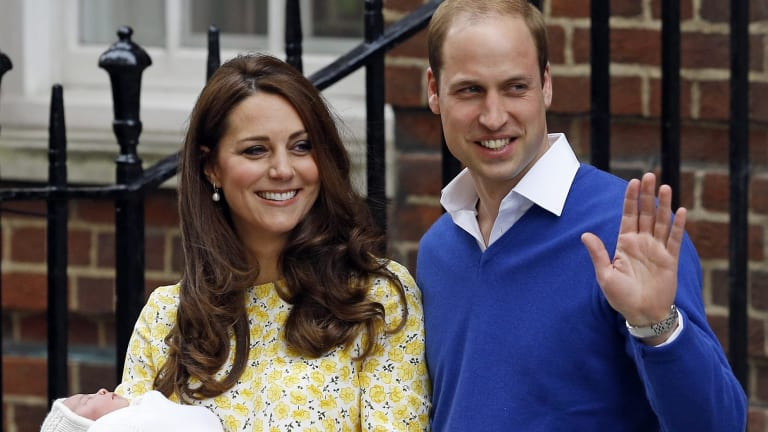 Princess Kate and Prince William smile as they show off their newborn Princess Charlotte from The Lindo Wing of St Mary's Hospital in London.