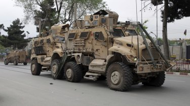 A damaged US military vehicle is pictured at the site of a suicide attack in Kabul, Afghanistan.