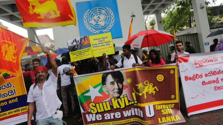 """Sri Lankan Buddhists express solidarity with Myanmar Buddhists, outside the UN office in Colombo on Wednesday. Sign in centre reads """"We do not want any Rohingya extremists who killed Buddhist monks""""."""