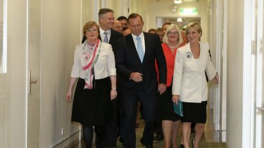 Prime Minister Tony Abbott arrives for the party room meeting at Parliament House.