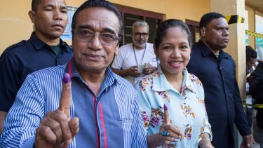 "East Timorese President Francisco ""Lu-Olo Guterres"" and his wife show their fingers after voting in Dili."