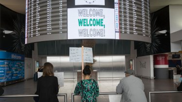 Volunteer lawyers greet arriving passengers in New York earlier this year as Donald Trump's travel ban heralded an immigration crackdown.