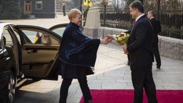 Ukrainian President Petro Poroshenko, right, greets Lithuanian President Dalia Grybauskaite in Kiev on March 21.
