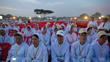 Members of Myanmar Catholic clergy gather to hear Pope Francis say Mass in Yangon, Myanmar, on Wednesday.