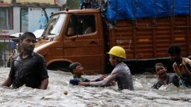 Children play in flood waters in Mumbai, India.