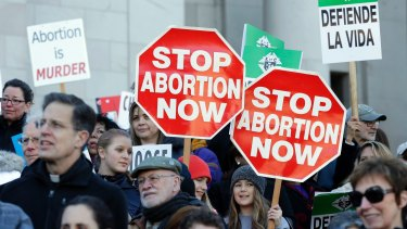Anti-abortion protesters rally in Washington on January 23, the day that President Trump signed the executive order.