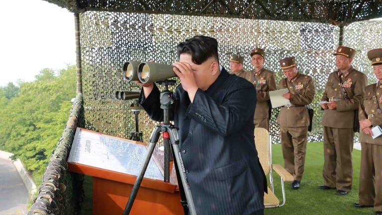 North Korean leader Kim Jong-Un inspecting a firing contest of artillery personnel in an undated picture released from North Korea's official Korean Central News Agency.