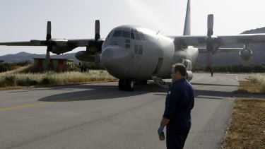 An engineer stands in front of a C-130 HAUP of the Hellenic Air Force, which took part in the searching operation of the missing EgyptAir plane.