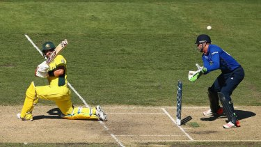 Australia's Aaron Finch sweeps strongly under clear skies at the MCG.