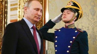 Russian President Vladimir Putin, left, walks past an honour guard before a meeting with his Brazilian counterpart Michel Temer at the Kremlin.