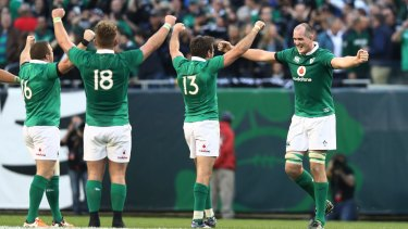111 years: Ireland players celebrate their historic win over the All Blacks.