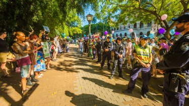 Police separated pro-life and pro-choice demonstrators outside Parliament House.