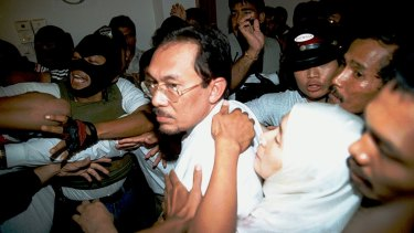 Former deputy prime minister Anwar Ibrahimwhen being escorted from his home in 1998.