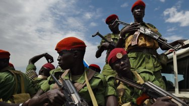 Troops loyal to Riek Machar on patrol in Juba in April, shortly after Machar's return to the capital.