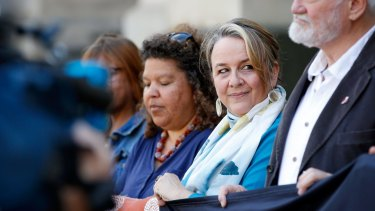 ''I'm absolutely elated'': Dimity Hawkins (second right), one of the founders of the ICAN, on the steps of Parliament House in Melbourne on Sunday.