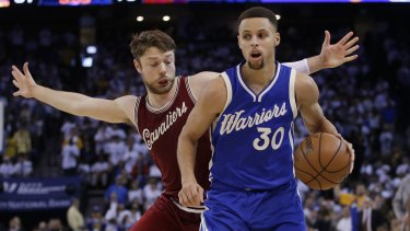 Golden State Warriors  Stephen Curry (right) dribbles past Cleveland  Cavaliers  Matthew Dellavedova 3e7d0581b