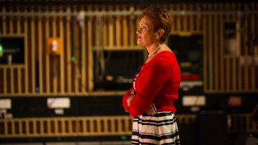 One Nation leader Pauline Hanson on the set of <i>Insiders</i>, watching host Barrie Cassidy.