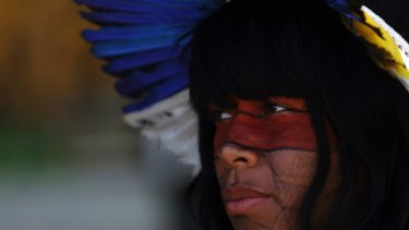 A Guarani woman protests against Brazilian President Michel Temer's plan to restrict land titles to indigenous communitiesin Brasilia on Wednesday.