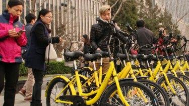Commuters unlock shared bikes using their smartphones in Beijing.
