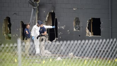 Huge holes were blown out of the side of the nightclub by police during the shooting.
