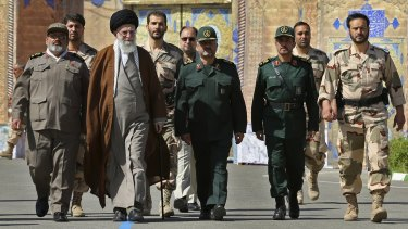 Iran's Ayatollah Ali Khamenei, third from left, with officers from the Iranian military.